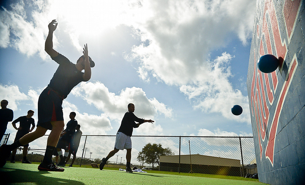 . Twins minor league players run drills while tossing small weighted balls. (Pioneer Press: Ben Garvin)