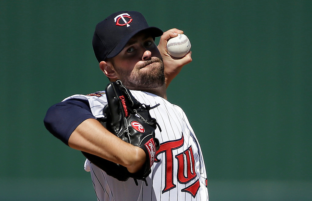 . Minnesota Twins pitcher Scott Diamond winds up for a warm-up throw in the second inning of an exhibition baseball game against the Boston Red Sox, Saturday, March 1, 2014, in Fort Myers, Fla. (AP Photo/Steven Senne)