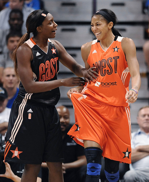 . East\'s Crystal Langhorne, left, of the Washington Mystics, left, and West\'s Candace Parker, of the Los Angeles Sparks, joke around during the second half. (AP Photo/Jessica Hill)