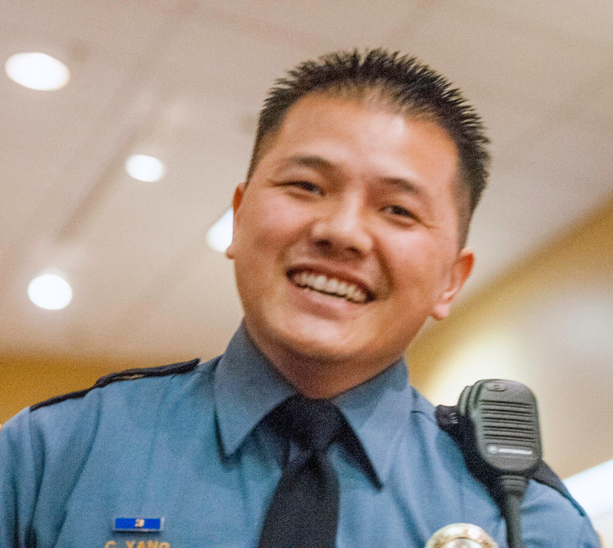 """. Officer Chou \""""Jim\"""" Yang smiles after he and his partner, Officer Yileng Vang, were honored as runners-up for Detectives of the Year. (Pioneer Press: Chris Polydoroff)"""