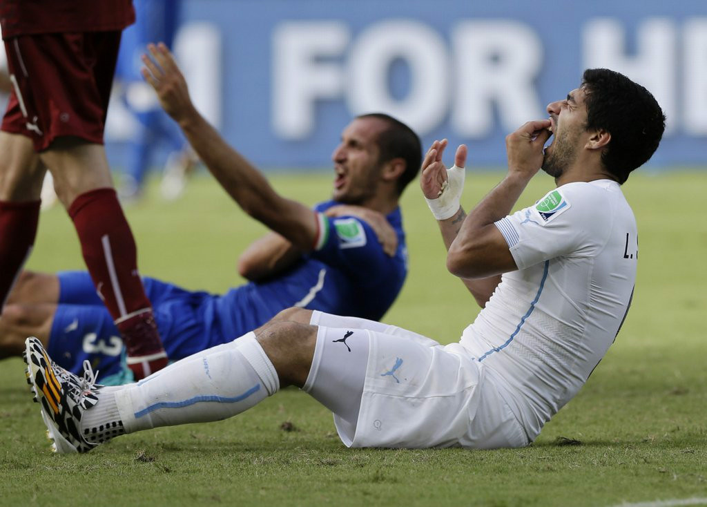 """. <p><b> Uruguayan soccer star Luis Suarez apologized for biting Italy�s Giorgio Chiellini during the World Cup, saying the incident occurred accidentally when he � </b> <p> A. Fell into Chiellini�s back <p> B. Blocked Chiellini with his teeth <p> C. Channeled Mike Tyson <p><b><a href=\' http://www.dailymail.co.uk/sport/worldcup2014/article-2675819/Luis-Suarezs-apology-biting-Giorgio-Chiellini-reasons-Barcelona-move.html\' target=\""""_blank\"""">LINK</a></b> <p>   (Associated Press)"""