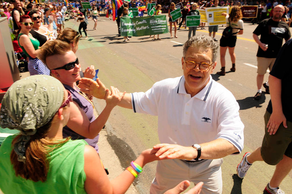 . U.S. Sen. Al Franken shakes hands with onlookers at the parade. (Pioneer Press: Scott Takushi)