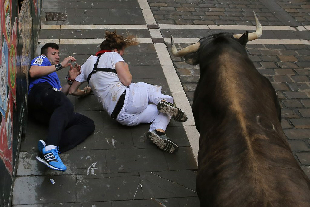 """. 7. RUNNING WITH BULLS <p>Not the smartest athletic pursuit for the slow and dumpy. (unranked) <p><b><a href=\'http://www.thewire.com/global/2014/07/surprise-surprise-people-were-injured-running-with-the-bulls-in-spain/374084/\' target=\""""_blank\""""> LINK </a></b> <p>    (AP Photo/Andres Kudacki)"""
