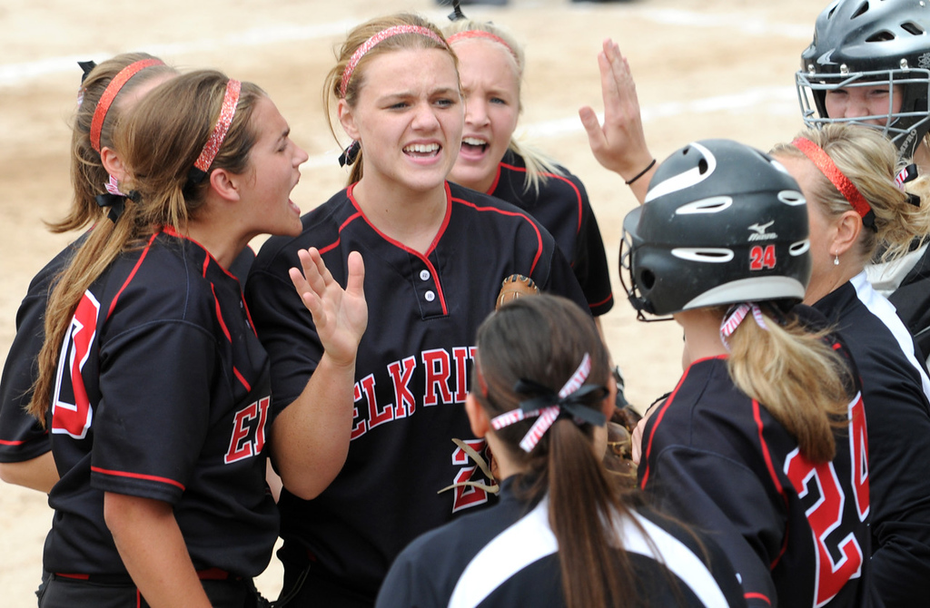 . Elk River pitcher Anna Pipenhagen, center, fires up her teammates after setting down Prior Lake in the third inning. (Pioneer Press: Jean Pieri)