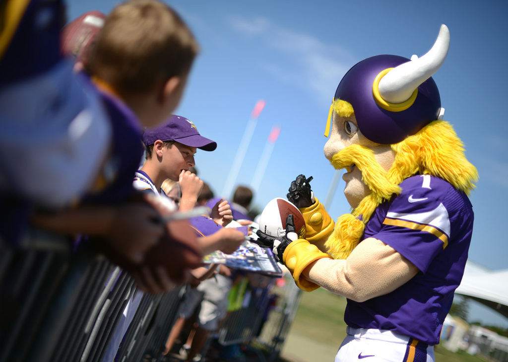 . Viktor the Vikings mascot signs for fans on the last day of training camp.  (Pioneer Press: Chris Polydoroff)