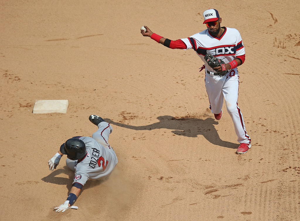 . White Sox shortstop Alexei Ramirez, right, relays the throw to first for a double play as Minnesota\'s Brian Dozier slides late into second in the seventh inning. (Photo by Jonathan Daniel/Getty Images)