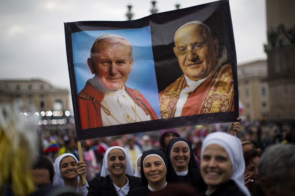 ". <p><b> Millions of pilgrims flocked to the Vatican on Sunday to witness the historic moment when Pope Francis officially declared Pope John Paul II and Pope John XXIII to be � </b> <p> A. Saints <p> B. Angels <p> C. His top two picks in the Papal Fantasy Draft <p><b><a href=\'http://www.twincities.com/breakingnews/ci_25647823/2-living-popes-honor-2-dead-ones-ceremony\' target=""_blank\""> LINK </a></b> <p>   (AP Photo/Emilio Morenatti)"