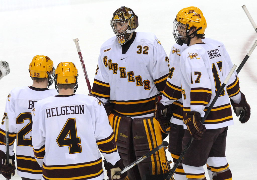 . Members of the Minnesota team skate to goaltender Adam Wilcox after the loss to Colorado College during the WCHA Final Five semifinals at the Xcel Energy Center Arena on March 22, 2013. (Pioneer Press: Sherri LaRose-Chiglo)
