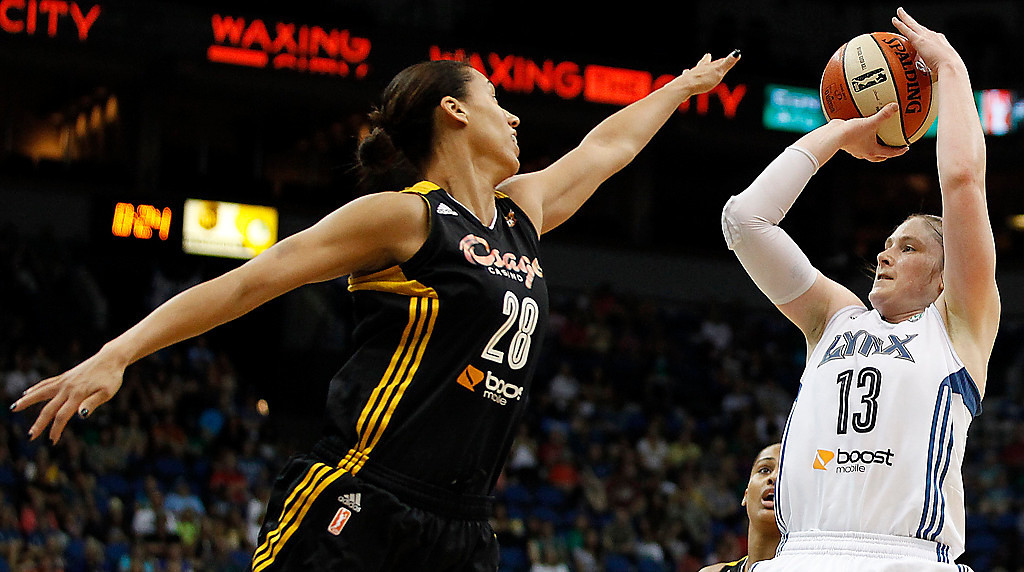 . Minnesota Lynx guard Lindsay Whalen (13) shoots against Tulsa Shock forward Nicole Powell (28) in the second half. (AP Photo/Stacy Bengs)