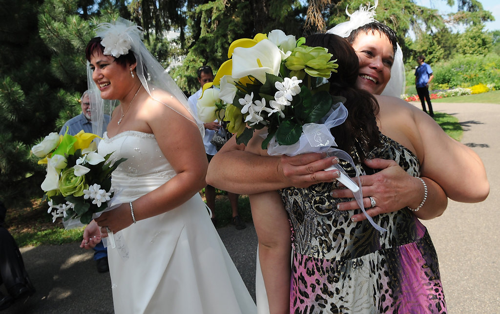 ". Shirley Otto, right,  and Rochelle ""Shay\"" Otto hug friends and family after their wedding.  (Pioneer Press: Jean Pieri)"