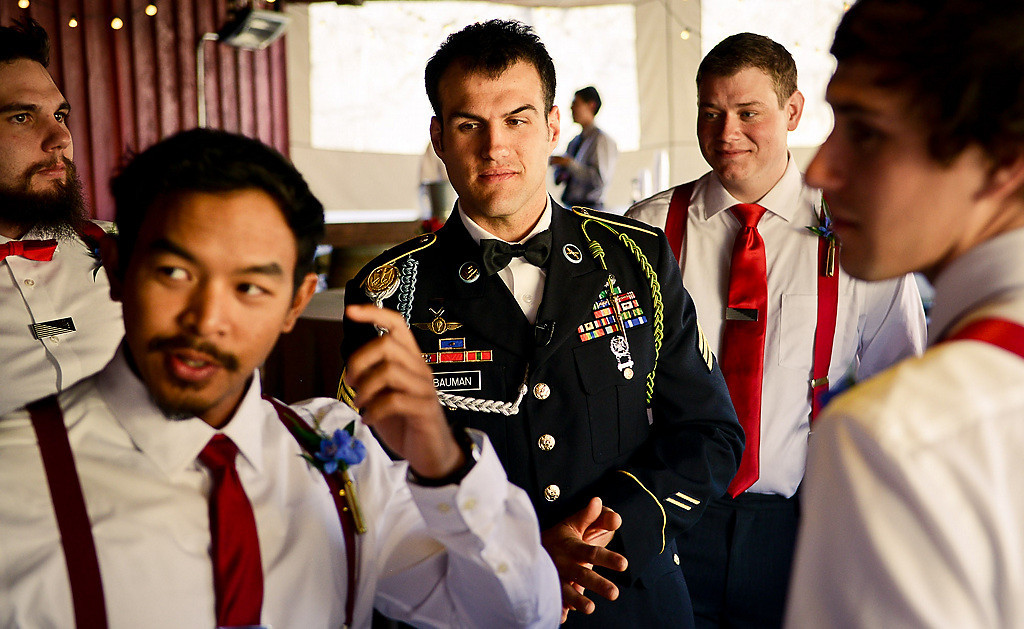 . Army Sgt. Cody Bauman, center, is surrounded by his groomsmen before his wedding to Paige Collins at Hope Glen Farm in Cottage Grove on Friday, April 11, 2014. Bauman, an 8-year veteran of the Army, and Collins had planned a quick wedding at the courthouse but were given a lavish $35,000 wedding in Cottage Grove as part of the Fairy Godmother Project Minnesota. (Pioneer Press: Ben Garvin)