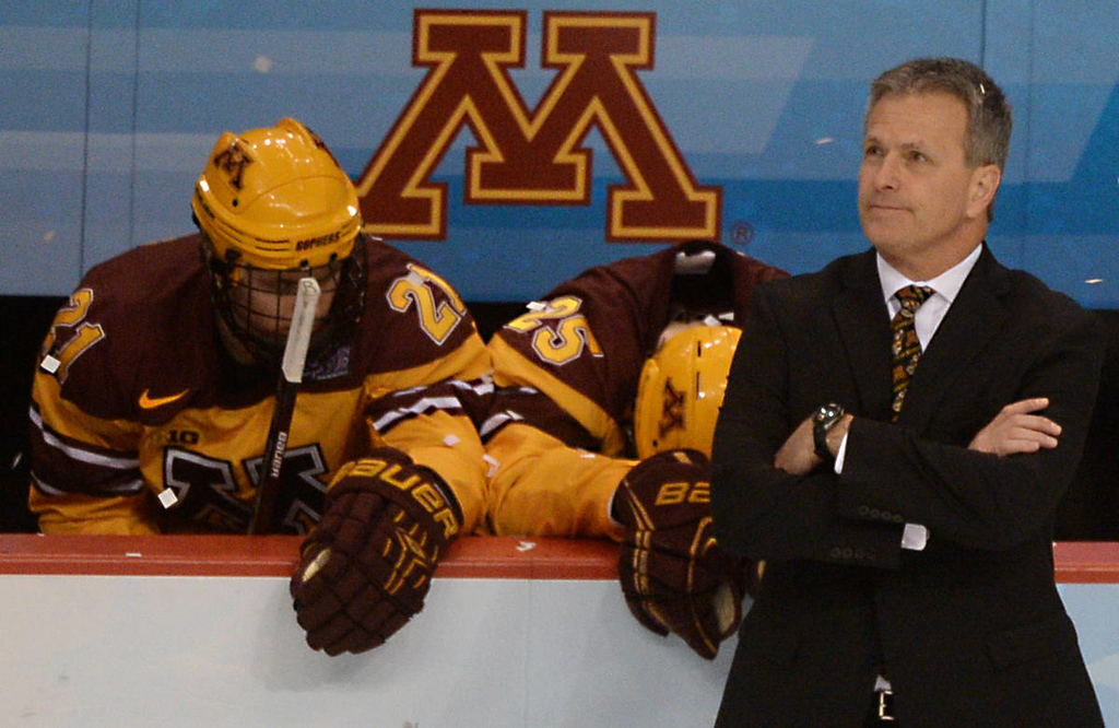 . It\'s a dejected Minnesota head coach Don Lucia who stands on the ice watching Union College celebrate their 7-4 victory over the Gophers in the NCAA Frozen Four Championship Game at the Wells Fargo Center in Philadelphia, Saturday, April 12, 2014. Behind Lucia is Minnesota freshman forwards Connor Reilly, left, and Justin Kloos. (Pioneer Press: John Autey)