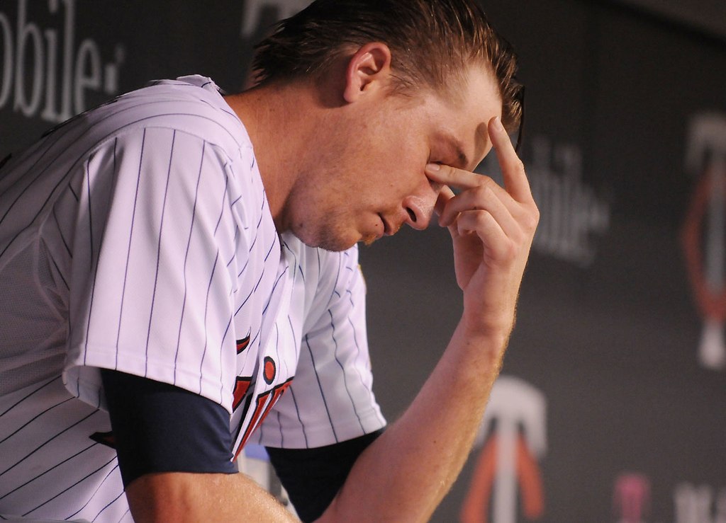 . Minnesota starting pitcher Kevin Correia rubs his eyes after getting pulled in the eighth inning. (Pioneer Press: John Autey)