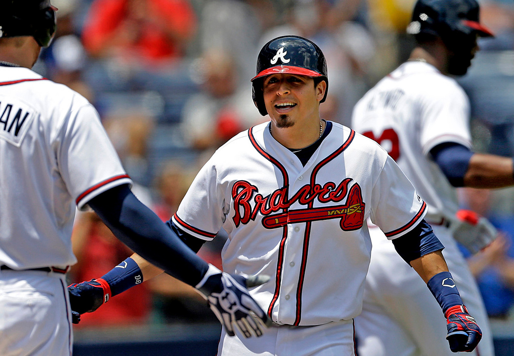 . Atlanta\'s Ramiro Pena, center, is greeted by teammate Freddie Freeman after hitting a solo home run in the third inning. (AP Photo/David Goldman)
