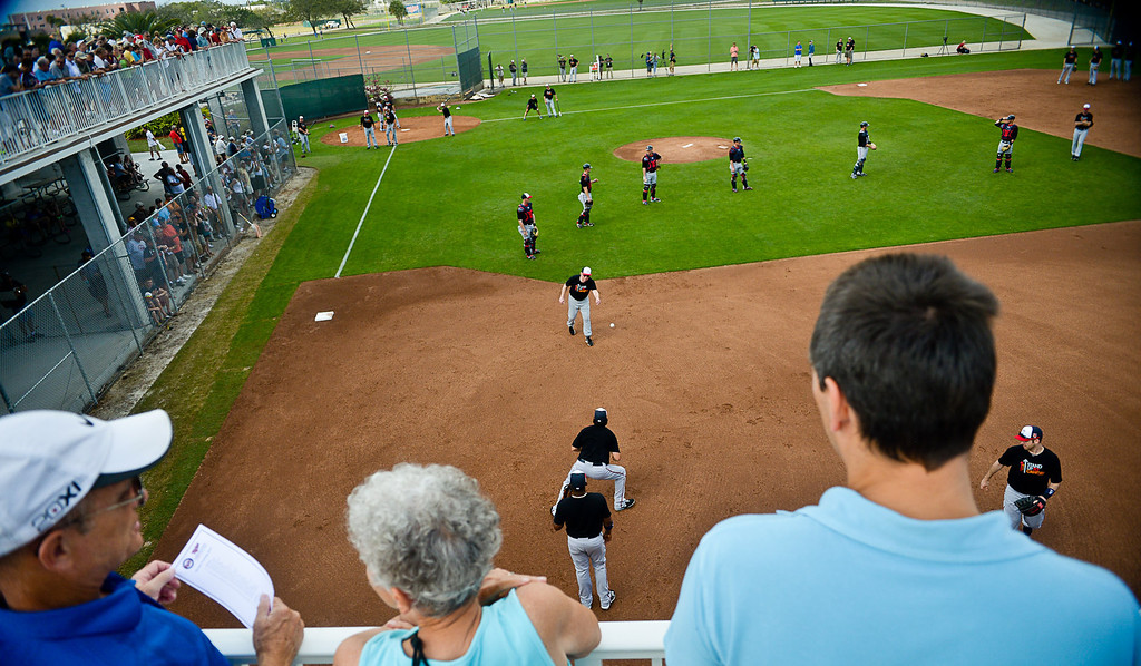 """. Fans watch as former Twins manager Tom Kelly conducts his famous infield drill called \""""Good Morning America.\"""" (Pioneer Press: Ben Garvin)"""