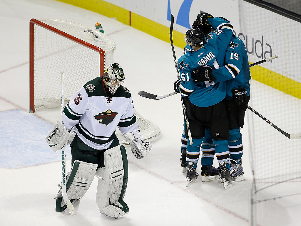 . Minnesota Wild goalie Darcy Kuemper (35) skates off the ice after being beaten for the game-winning goal by San Jose Sharks\' Joe Thornton (19) during overtime of an NHL hockey game on Saturday, Jan. 25, 2014, in San Jose, Calif. San Jose won 3-2 in overtime. (AP Photo/Marcio Jose Sanchez)