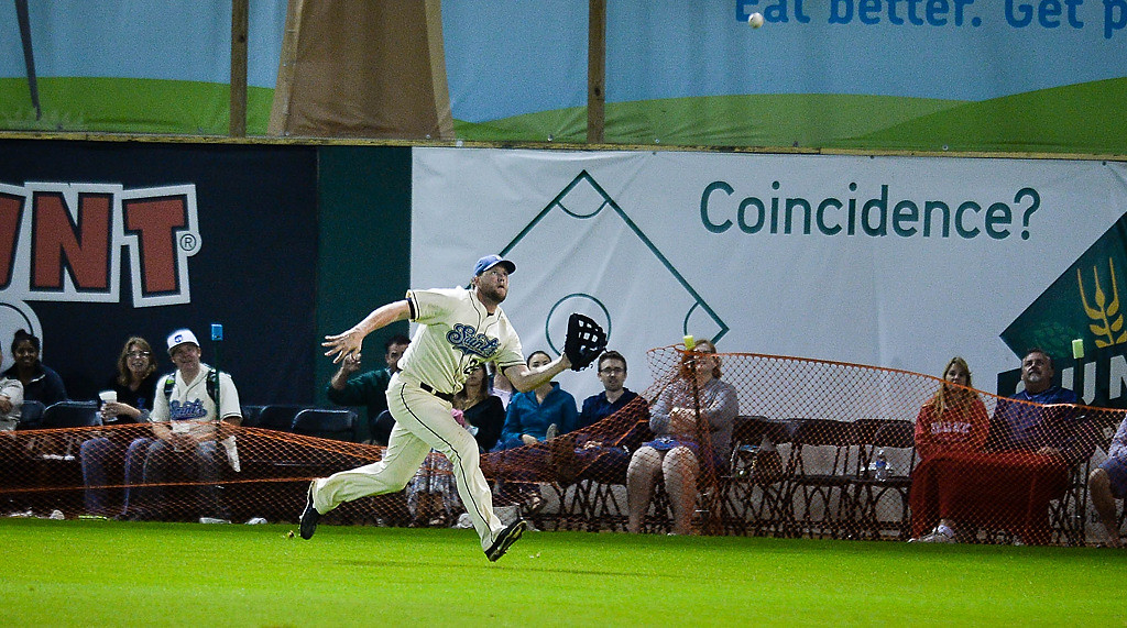 . Outfielder Joe Bonfe catches a fly ball in front of fans seated on the warning track late in the game. (Pioneer Press: Ben Garvin)
