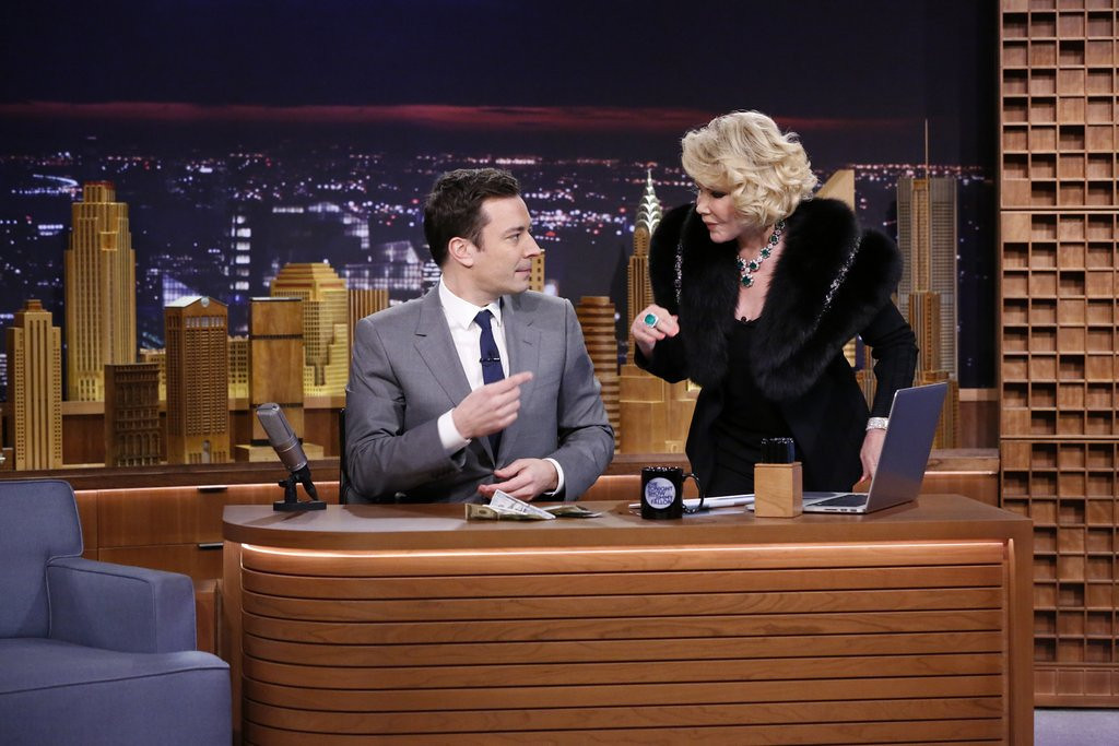 """. <p><b> TV history was made by Jimmy Fallon on Monday night when, for the first time in 42 years, �The Tonight Show� � </b> <p> A. Returned to its original New York studios <p> B. Was broadcast live <p> C. Featured the corpse of Joan Rivers <p><b><a href=\'http://www.twincities.com/entertainment/ci_25167114/first-night-hit-tonight-host-jimmy-fallon\' target=\""""_blank\"""">HUH?</a></b> <p>   (AP Photo/NBC, Lloyd Bishop)"""