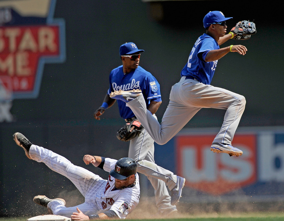 . Twins base runner Ryan Doumit is out at second base as Royals shortstop Alcides Escobar, right, turns a double play during the eighth inning. Watching the play is Royals second baseman Miguel Tejada.  (Photo by Hannah Foslien/Getty Images)