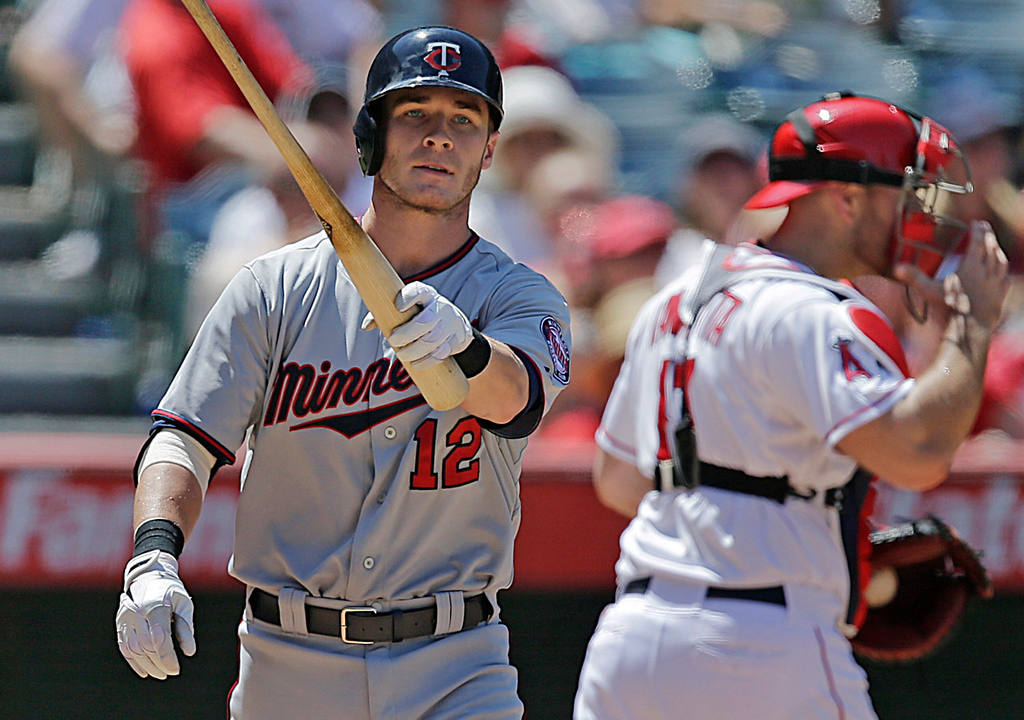 . Minnesota\'s Chris Herrmann reacts after striking out during the seventh inning against Angels starter Jared Weaver. Herrmann whiffed three times during the game.  (AP Photo/Jae C. Hong)