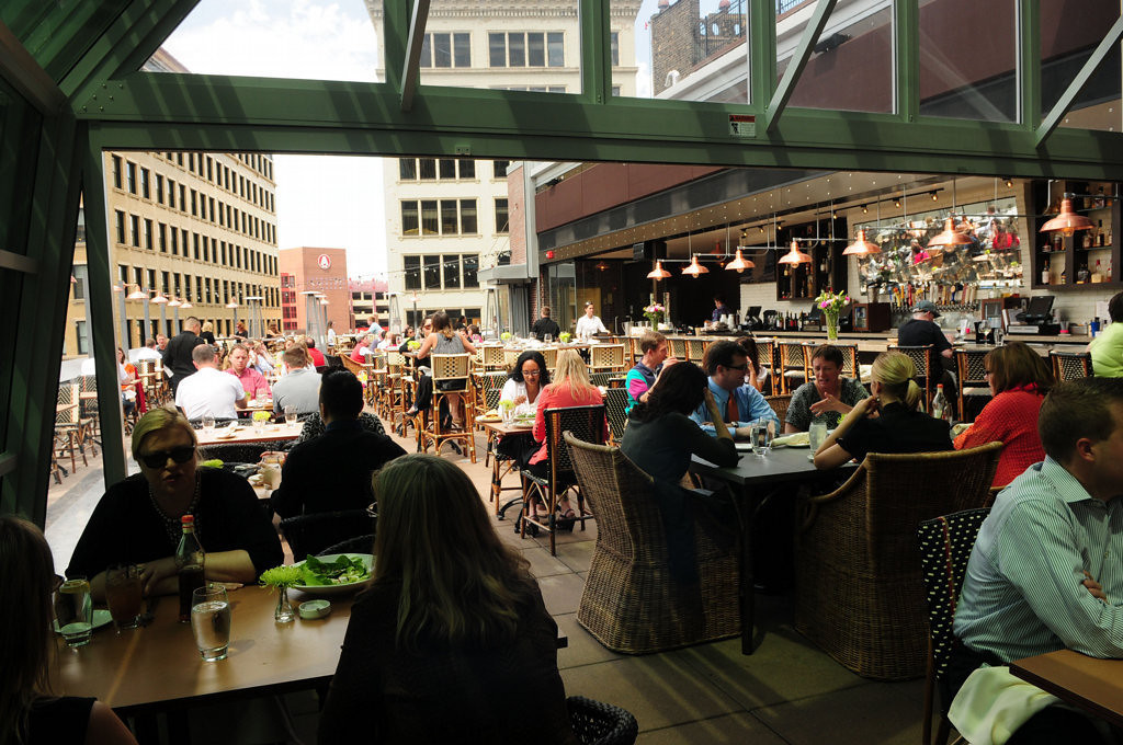 . Part of Union Restaurant\'s upstairs patio in downtown Minneapolis is covered by a retractable roof, while most of it is open to the sky. (Pioneer Press: Scott Takushi)