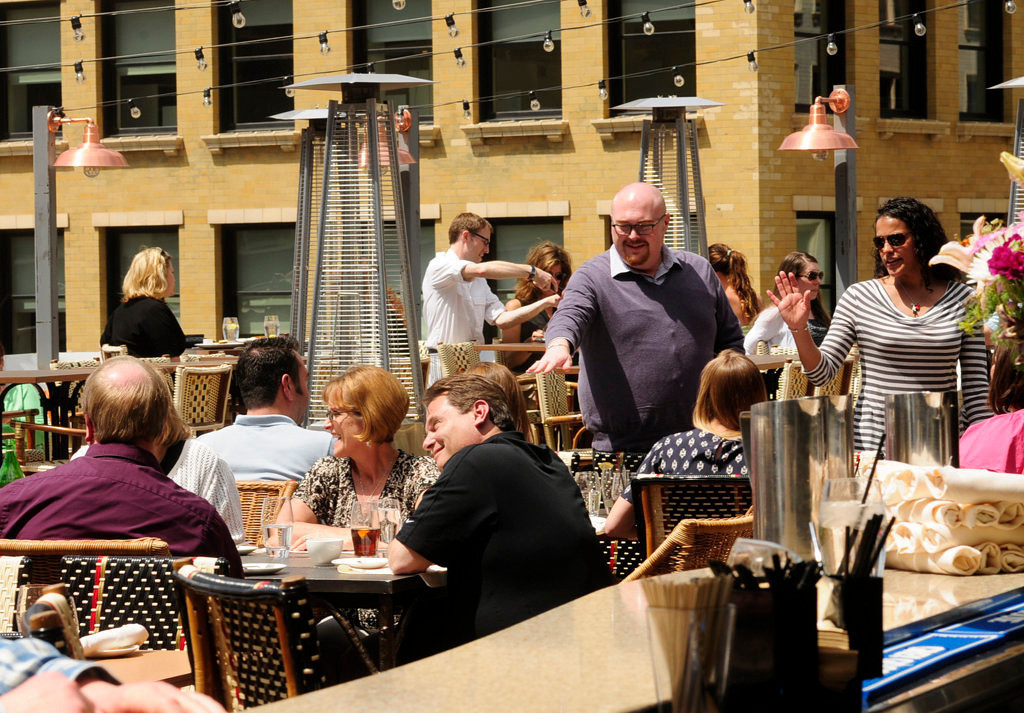 . The lunch crowd basks in the sun at Union Restaurant\'s third floor patio on Tuesday, May 14, 2013. (Pioneer Press: Scott Takushi)