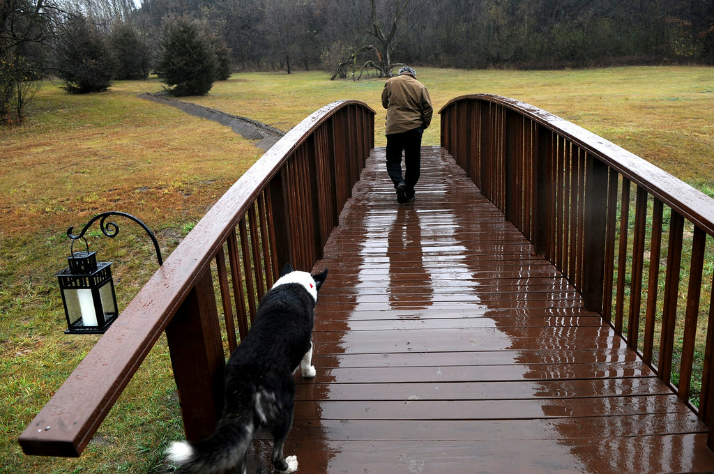 . Michael Bushilla shows the bridge that couples walk across before getting married. (Pioneer Press: Jean Pieri)