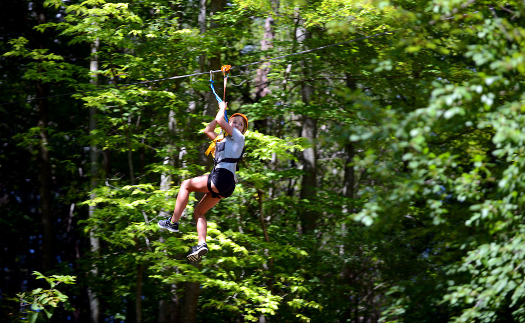 . Osceola, Wisconsin resident Geena Challeen, 13, enjoys a ride through the woods on one of the zip lines at the Aerial Adventure Park at Trollhaugen.   (Pioneer Press: Chris Polydoroff)