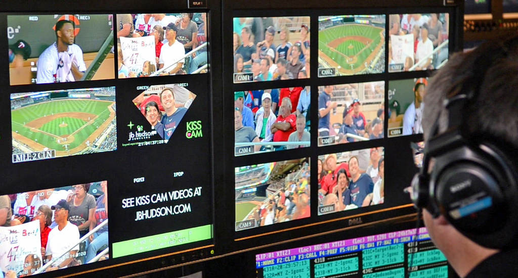 . Multiple cameras around the stadium feed into monitors in the control room as the sixth-inning Kiss Cam is broadcast. (Pioneer Press: C.J. Sinner)