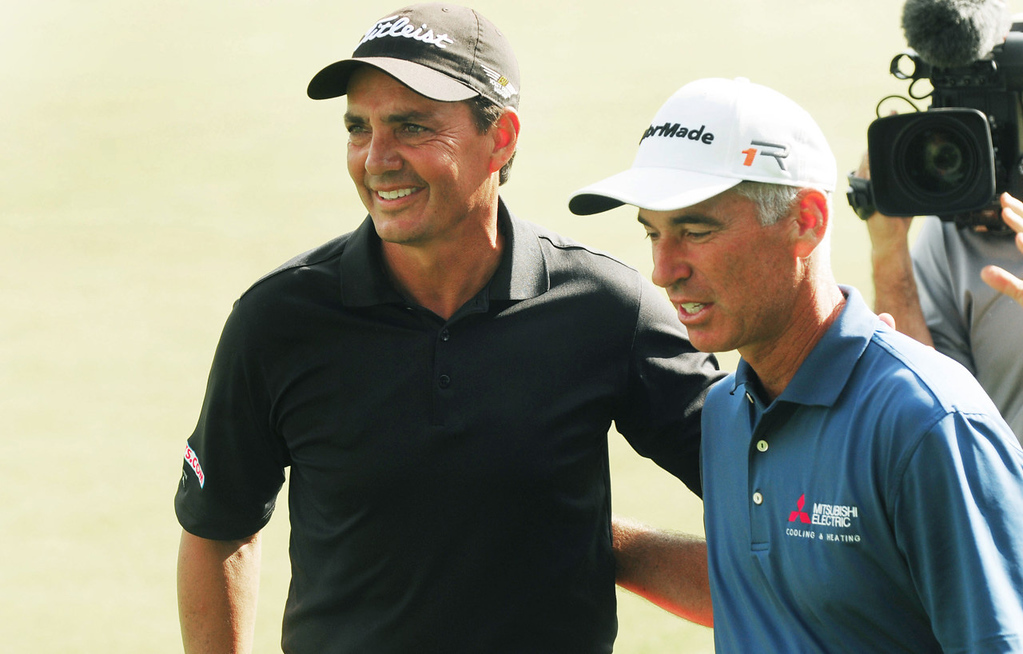 . Tom Pernice Jr., left, and Corey Pavin congratulate each other after both birdied the 18th hole on the final day of the 2013 3M Championship at TPC Twin Cities in Blaine on Sunday August 4, 2013. Pernice, Jr. finished at 17 under par, one stroke ahead of Pavin, to win the championship and a $262,500 pay day. (Pioneer Press: Scott Takushi)