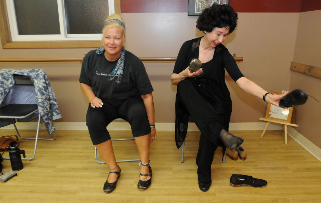. Mikki Ubel, left, began dancing lessons with Nancy Raddatz when she was 2. After living in California, she returned to the Twin Cities and has been dancing with Raddatz for the past 15 years. The two change shoes to begin the tap portion of their Wednesday night class.   (Pioneer Press: Ginger Pinson)