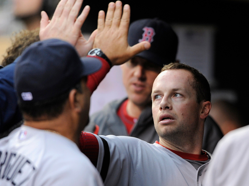 . Daniel Nava of the Boston Red Sox celebrates scoring a run against the Minnesota Twins during the first inning.  (Photo by Hannah Foslien/Getty Images)