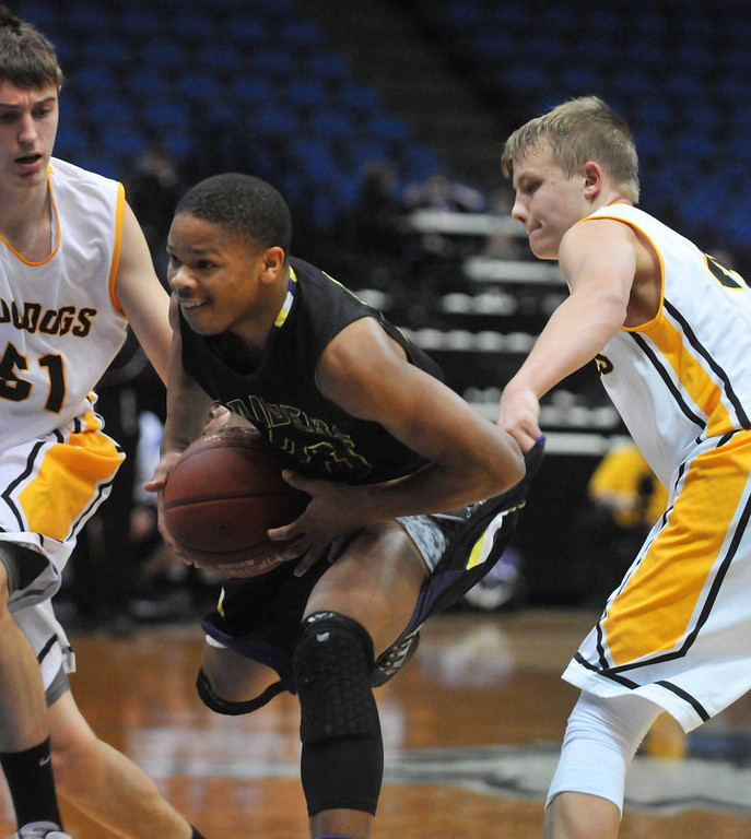 . Cretin-Derham Hall\'s  Brian Lankford-Johnson drives to the basket between two Bettendorf\' (Iowa) defenders. (Pioneer Press: Scott Takushi)