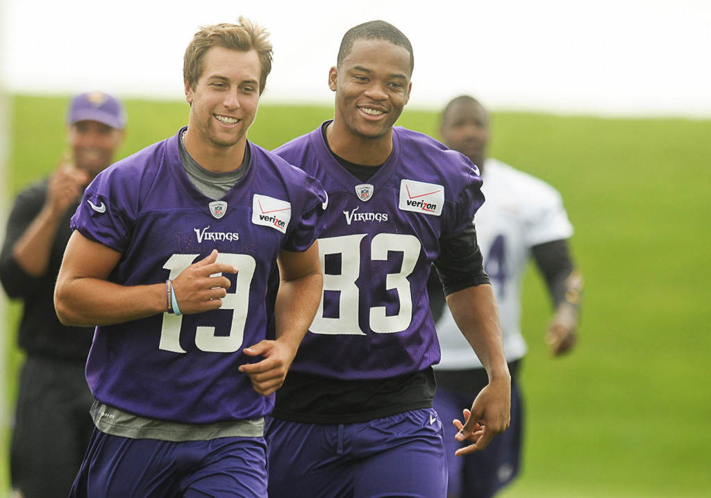 . Wide receiver Adam Thielen, left, and wide receiver Rodney Smith head off the field Friday morning. (Pioneer Press: Ben Garvin)