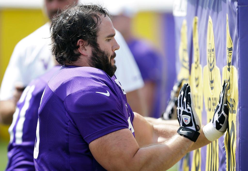 . Vikings center John Sullivan participates in a hands drill. (AP Photo/Charlie Neibergall)