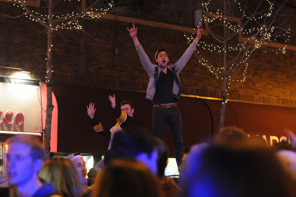 . A few fans jump atop cars at the intersection as they scream and yell on Saturday night. (Pioneer Press: Sherri LaRose-Chiglo)