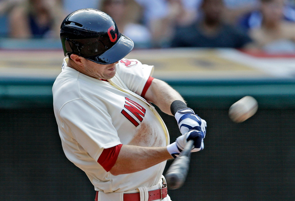 . Cleveland\'s Drew Stubbs sends a solo shot over the center field wall off  Twins reliever Jared Burton in the eighth inning, breaking a 1-1 tie. (AP Photo/Mark Duncan)