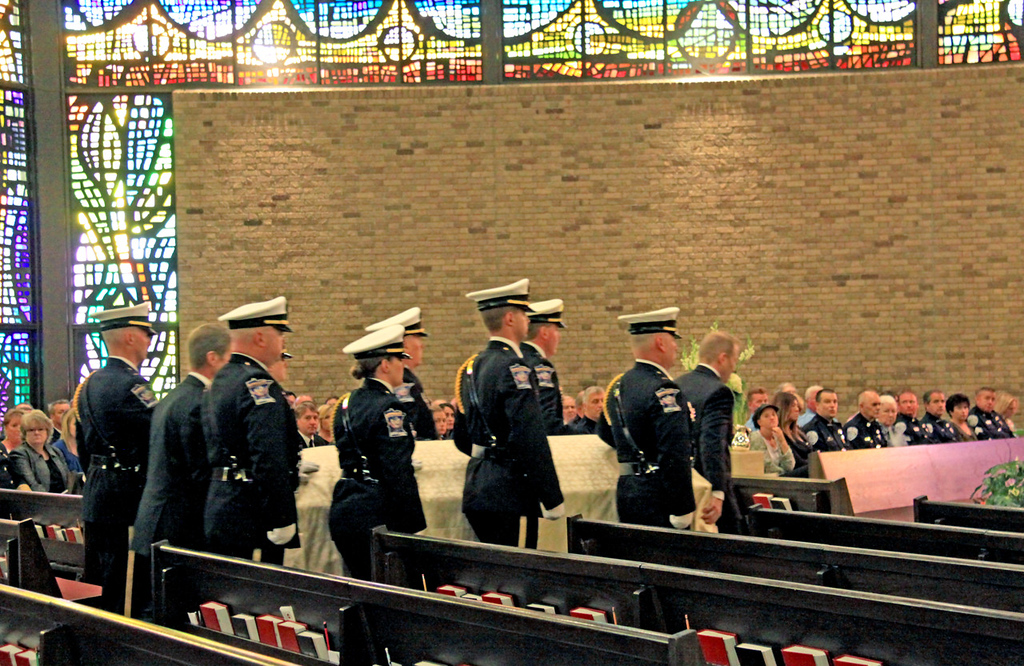. Officers escort the casket of Mendota Heights police officer Scott Patrick during his funeral service at St. Stephen\'s Lutheran Church in West St. Paul on Wednesday.  (Minnesota Department of Public Safety Pool Photo: Jen Longaecker)