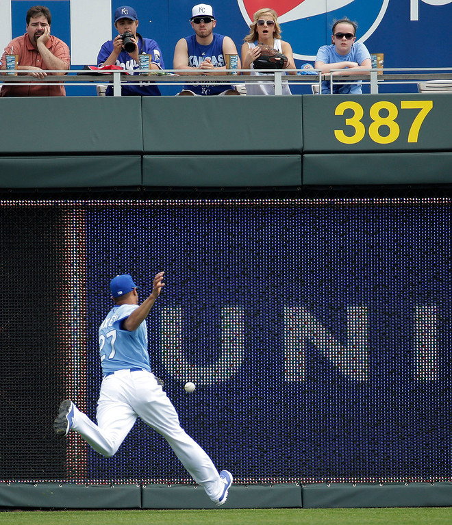 . Kansas City Royals right fielder Justin Maxwell chases a two-run double by Minnesota Twins\' Trevor Plouffe during the first inning. (AP Photo/Charlie Riedel)