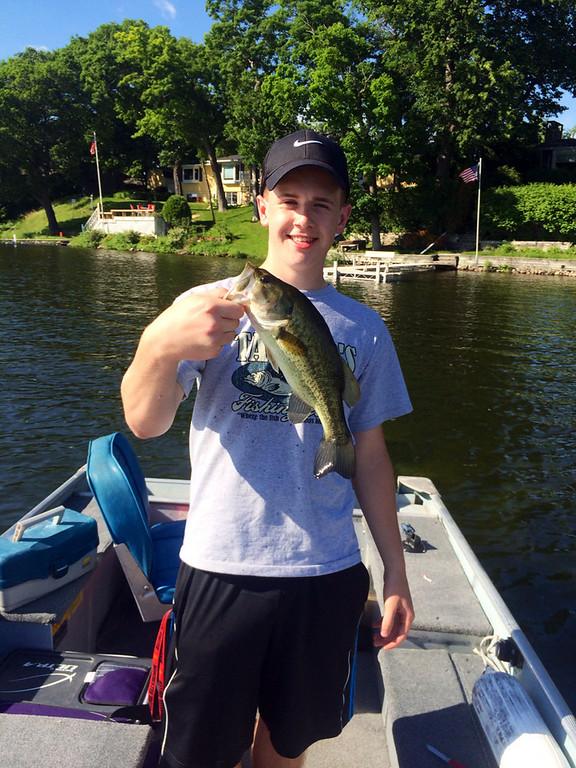 ". Collin Dworak, 17, of Mahtomedi, caught this 13-inch largemouth bass June 20 on Bald Eagle Lake. Says his grandmother, Gayle Dworak: \""Boy, boat, Bald Eagle, Bass....Bravo!\"" (Photo courtesy Gayle and Collin Dworak)"