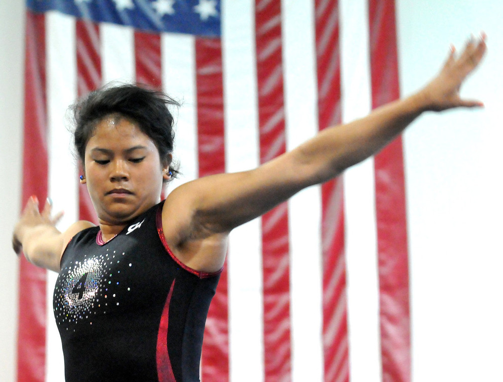 . Gymnast Mary Jane Rott begins her balance beam routine during her last workout at Rising Stars Gymnastic Academy in Oakdale on Tuesday June 18, 2013. The 18-year-old is headed to Alabama\'s Auburn University on a full scholarship.   (Pioneer Press: John Doman)