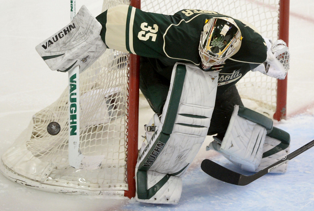 . Minnesota Wild goalie Darcy Kuemper deflects a puck during the third period.  (Pioneer Press: Sherri LaRose-Chiglo)