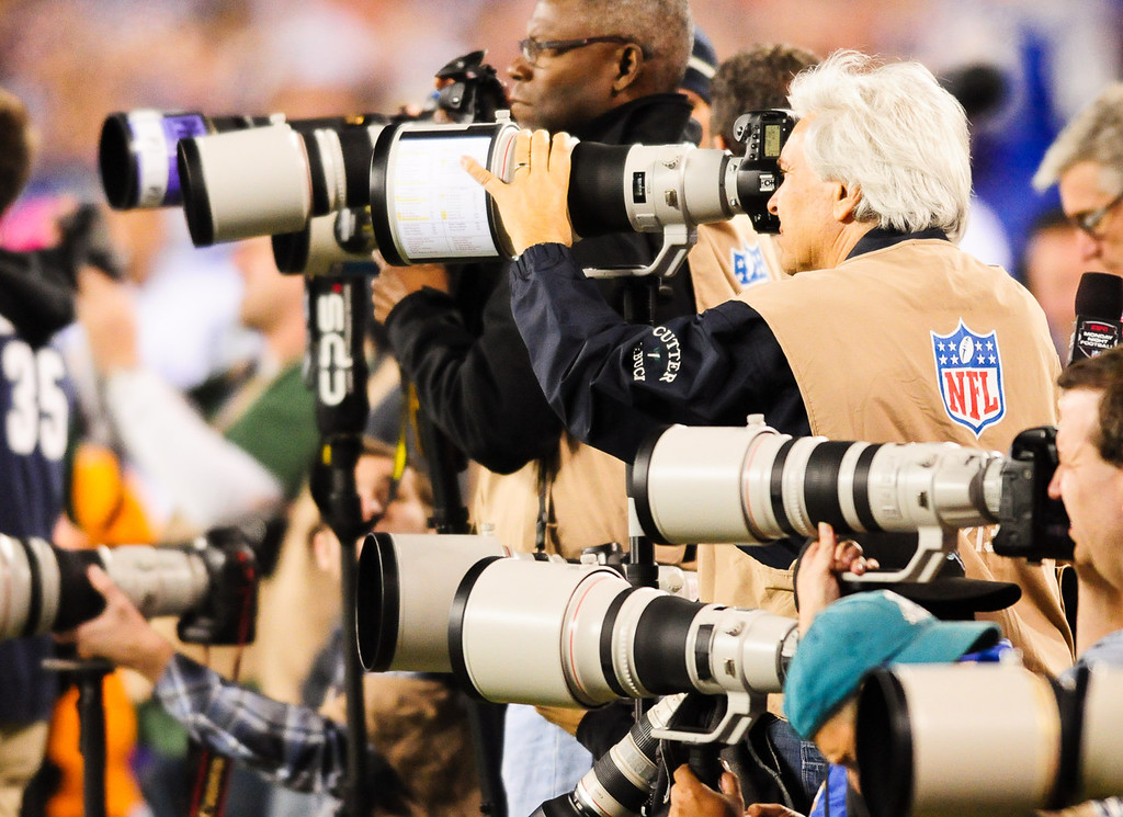 . Photographers work the game during the first quarter as the Vikings play the  Giants.  (Pioneer Press: Ben Garvin)