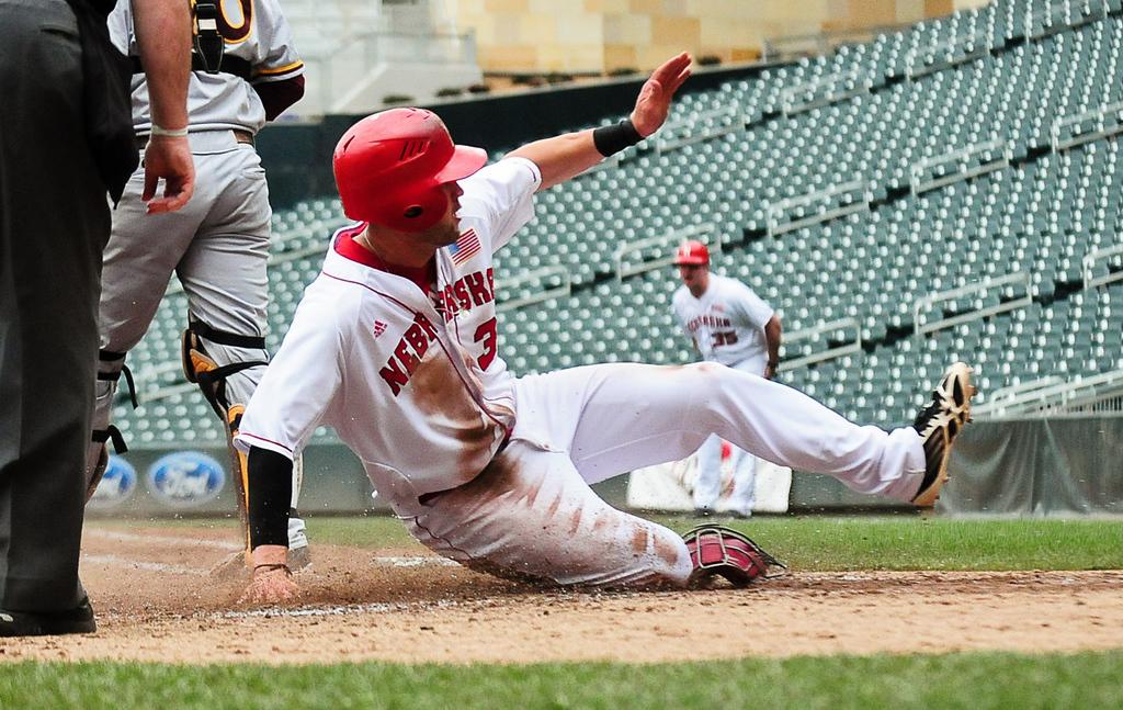 . Nebraska\'s Kash Kalkowski slides home to score in the fourth inning. (Pioneer Press: Ben Garvin)