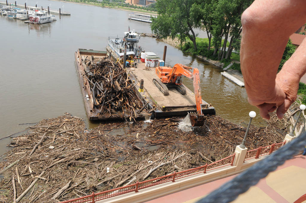 . A man leans over the Wabasha Street Bridge and watches the logjam cleanup. (Pioneer Press: Jean Pieri)