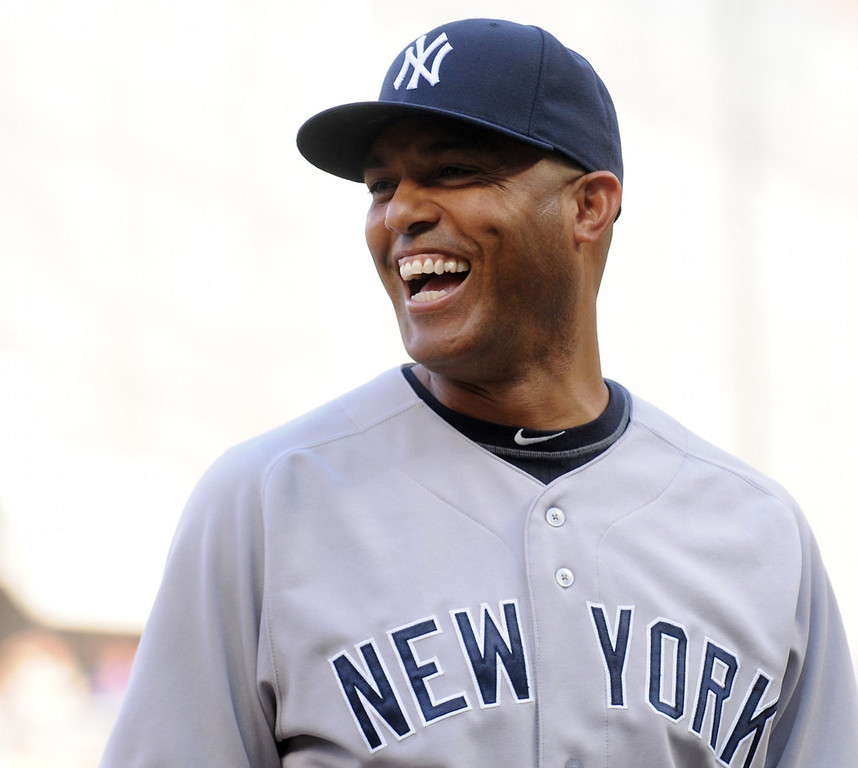 . Yankees relief pitcher Mariano Rivera smiles as he is introduced to the crowd before the game. (Pioneer Press: John Autey)