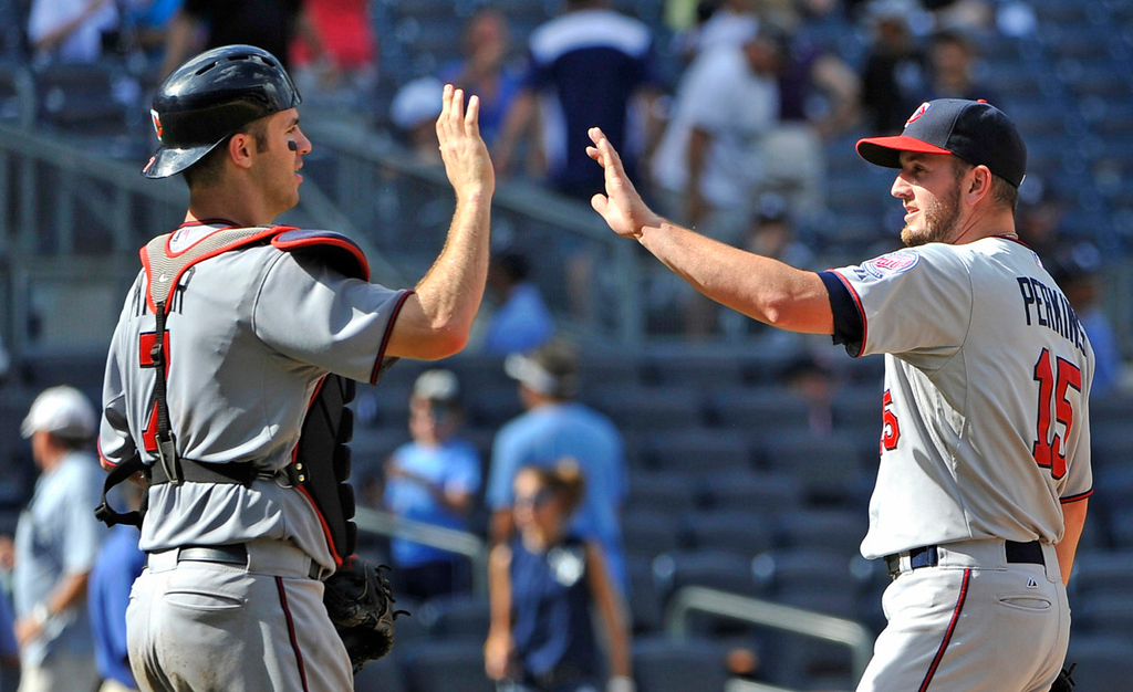 . Twins All-Star teammates Joe Mauer, left, and pitcher Glen Perkins celebrate Minnesota\'s 10-4 win over the Yankees. (AP Photo/Kathy Kmonicek)