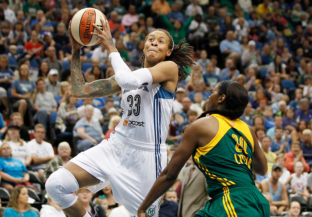 . Minnesota Lynx guard Seimone Augustus (33) goes up for a shot against Seattle Storm forward Camille Little (20) in the first half. Augustus scored 18 points to help the Lynx beat the Storm. (AP Photo/Stacy Bengs)