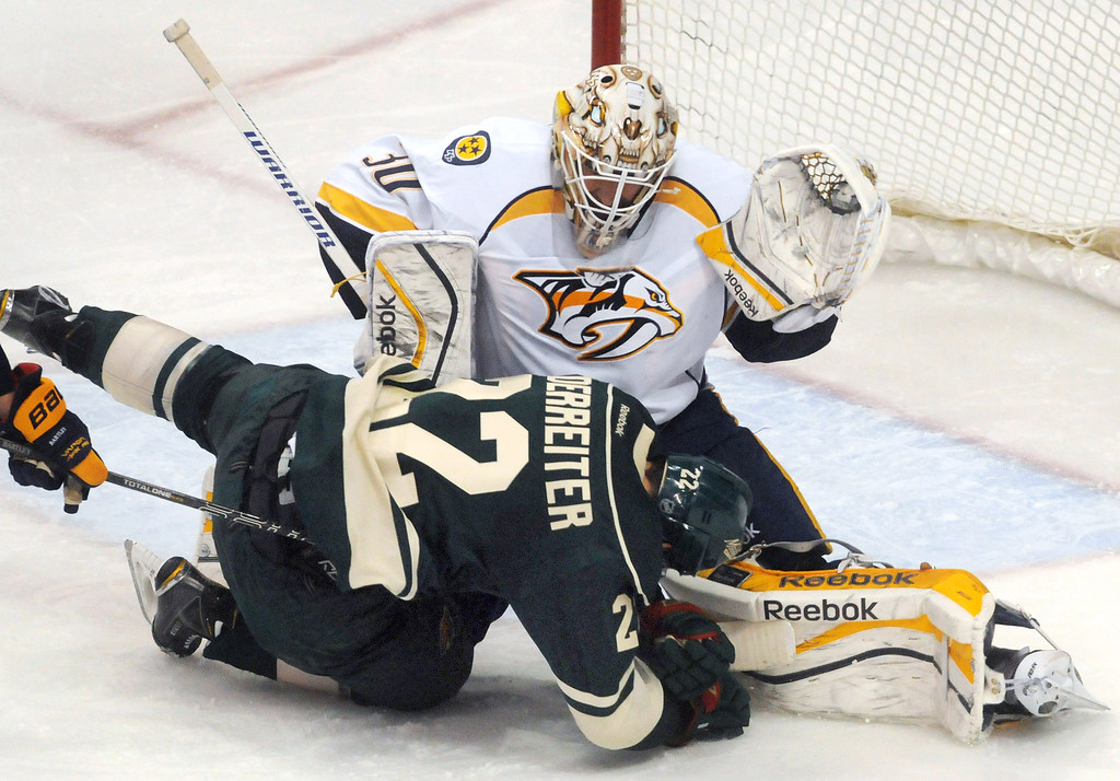 . The Wild\'s Nino Niederreiter crashes into Nashville goalie Carter Hutton in the second period as the Minnesota Wild played their last game of the season.  (Pioneer Press: Scott Takushi)