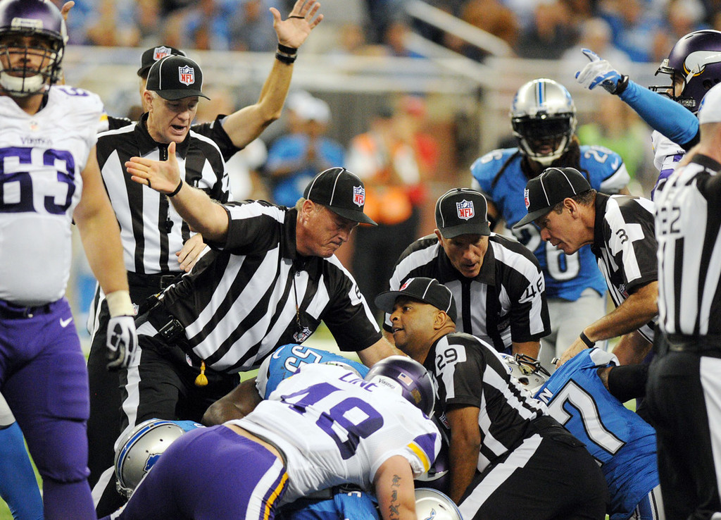 . Officials signal a Lions recovery of a fumble by Vikings quarterback Christian Ponder in the fourth quarter.  (Pioneer Press: Chris Polydoroff)